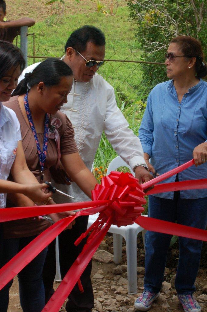 Ribbon cut by community leaders