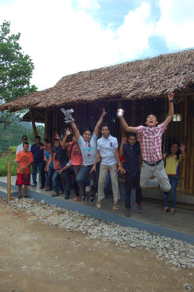 Foundation University work crew jump for joy