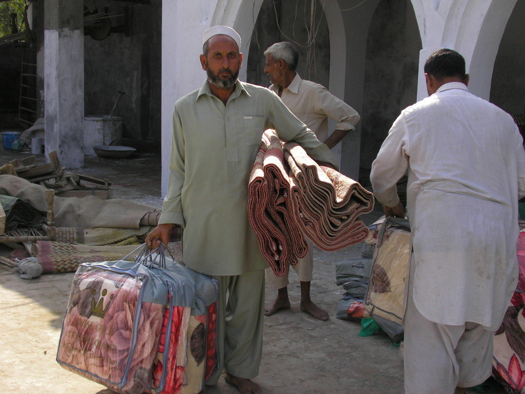 Distributing blankets and floor coverings