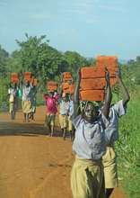 Students ferrying bricks for their school June2014