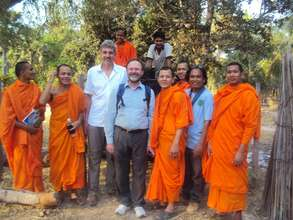 Monks of BFT standing with BFT volunteers
