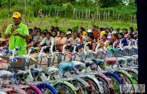 Sedtha standing amongst the bicycle donations