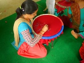 A women in Embrodary training program.