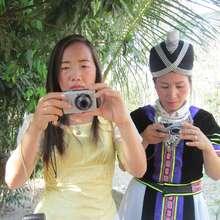 Women practice their camera skills in Laos