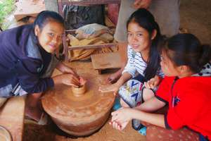 Making a clay pot at the Pottery Village