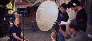 Singkham prepares to tell a Tai Lue folktale.