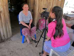 Pasong conducts an interview in her home village