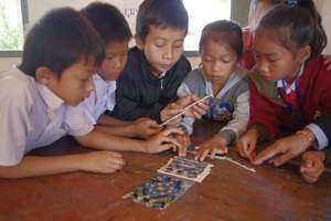 Students at Phonesaat Primary School with a Puzzle