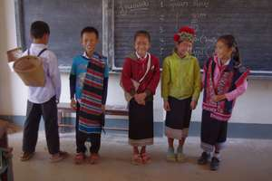 Students demonstrate wearing ethnic clothing.