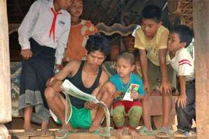 Bringing books to villagers during research trip