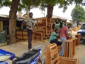 Beneficiaries working in carpentry workshop
