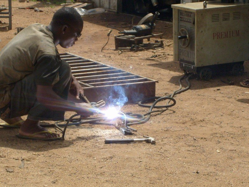 Welding beneficiary concentrateing on his job