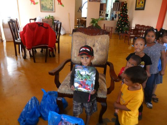 Children receive their Christmas toys