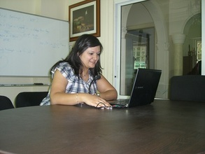 A staff having a skype meeting with Juba staff.