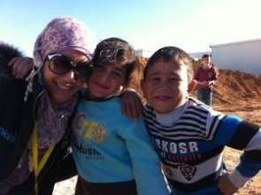 A newcomer and kids in the camp