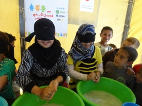 Children playing the hand-washing game