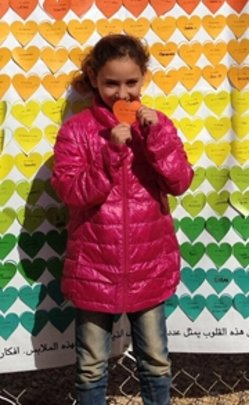 Girl happily tries on her new coat