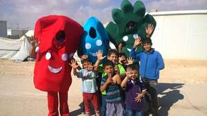 Our 'hygiene mascots' with children