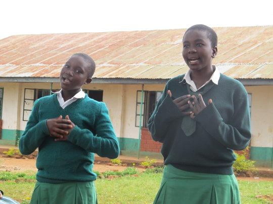 Students singing in the schoolyard, Kenya