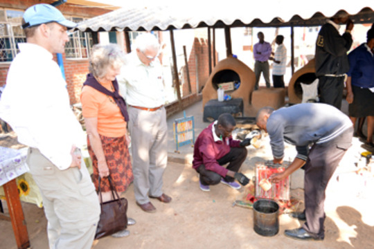 Our international guests observing candle-making