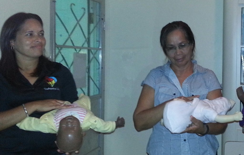 CPR Training with baby dolls.