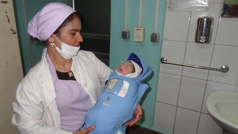 Nurse with a baby in Embrace