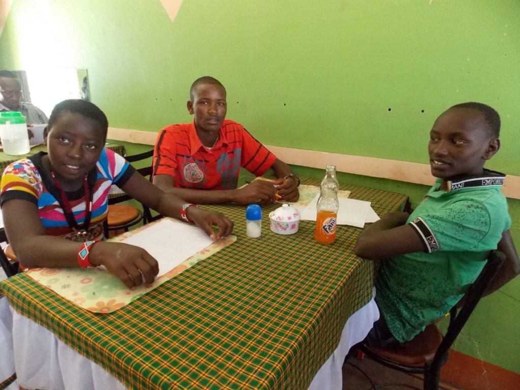 Scholarship winners Felister, Matthew & Innocent