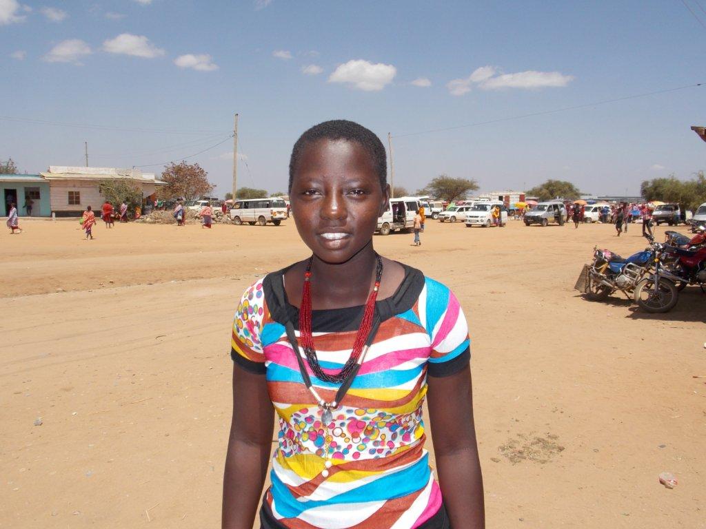 New scholarship winner Felister at Mile 46 Market