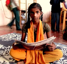 Ponmani reading alound the local English newspaper