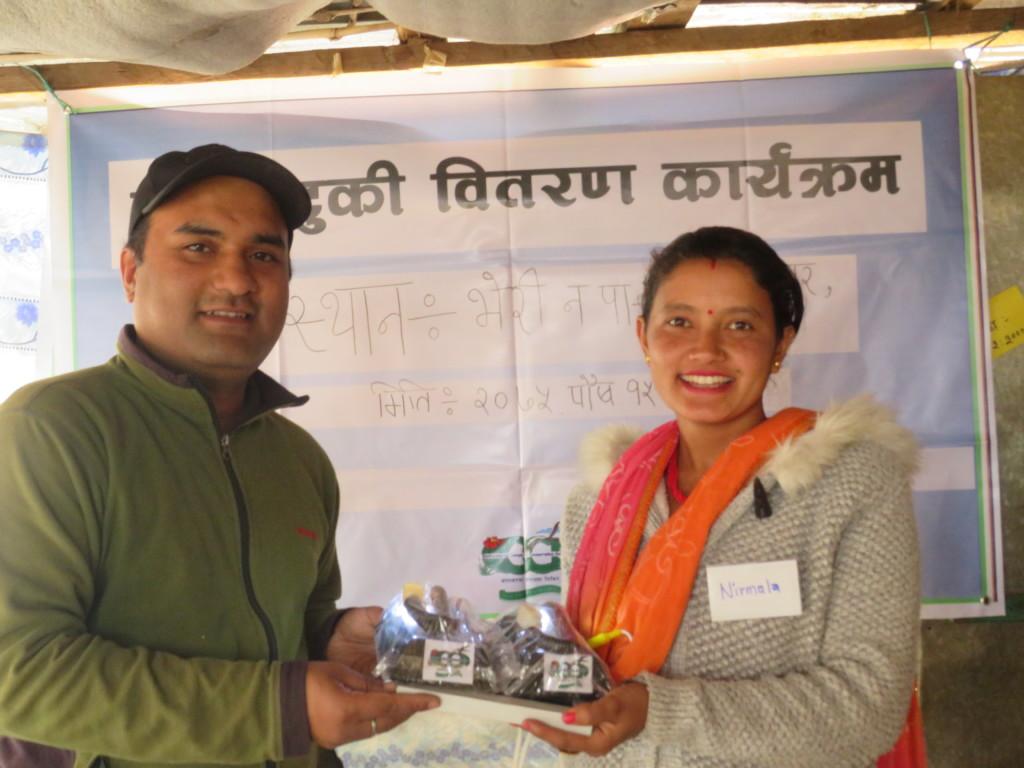 Local woman receiving solar tuki lamp