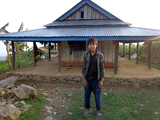 Milan showing his house in Warangi VDC.
