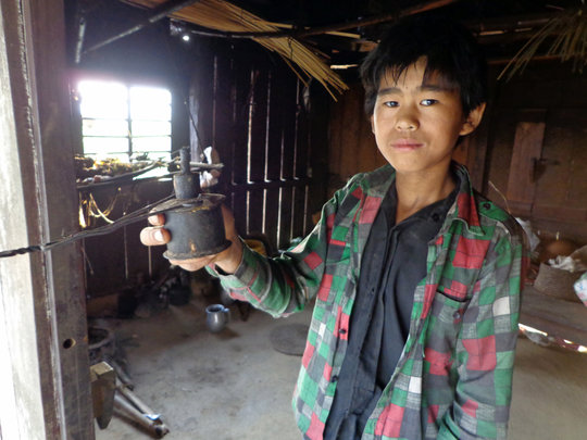 Milan, with his kerosene light used for study.
