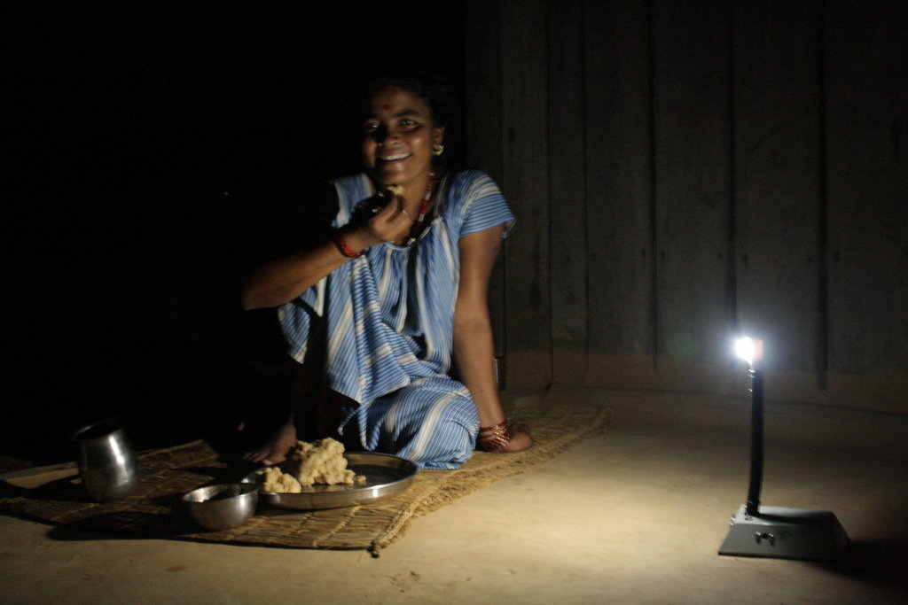 This picture was taken in one of the remote place of Chitwan District. The women portrayed in this picture don't use kerosene tuki any more to lighten the house. Her smile captured in this picture shows the level of her happiness.