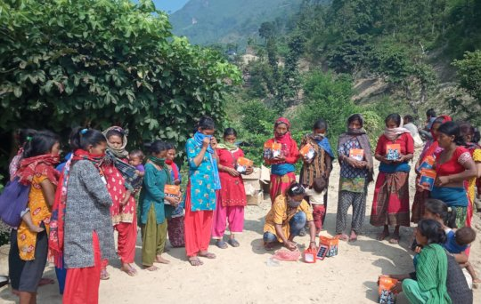 solar lamps distributed to women group members