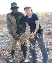 Hannah and the village Headman gathering twigs.