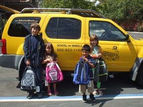 Students receiving backpacks