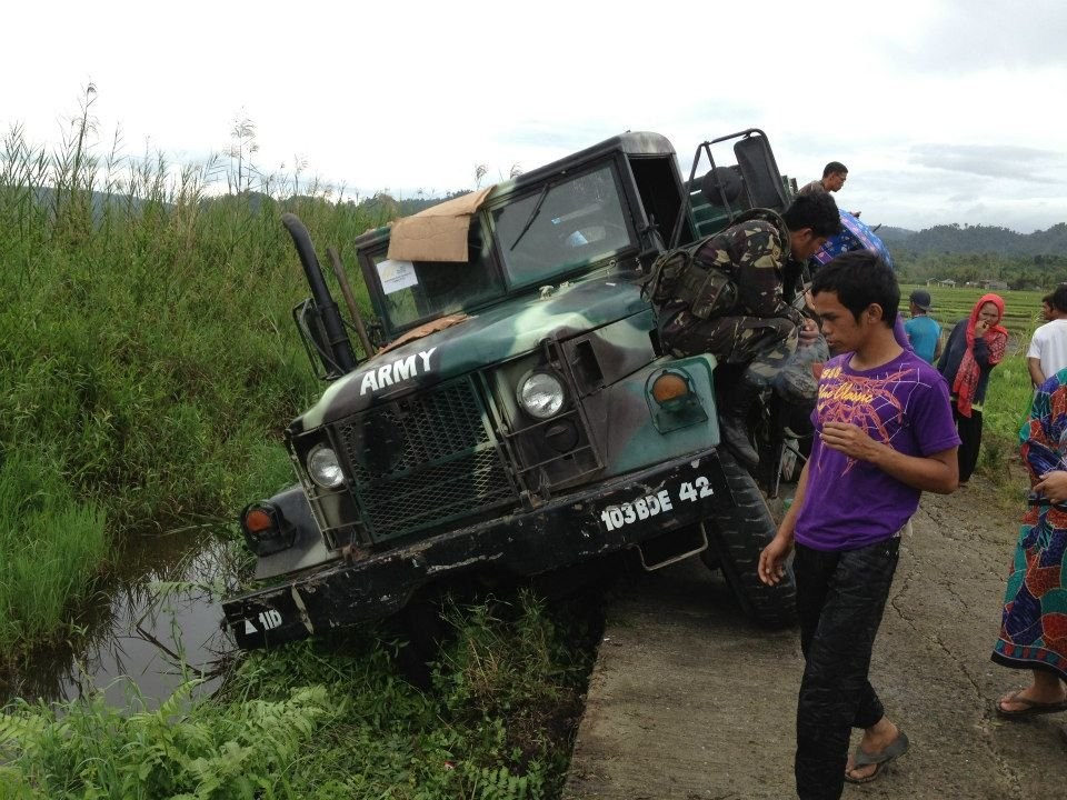 AAI relief truck slides off road