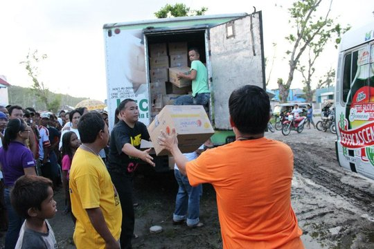 Trucks filled with supplies aid villagers