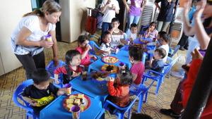 Little children having tea