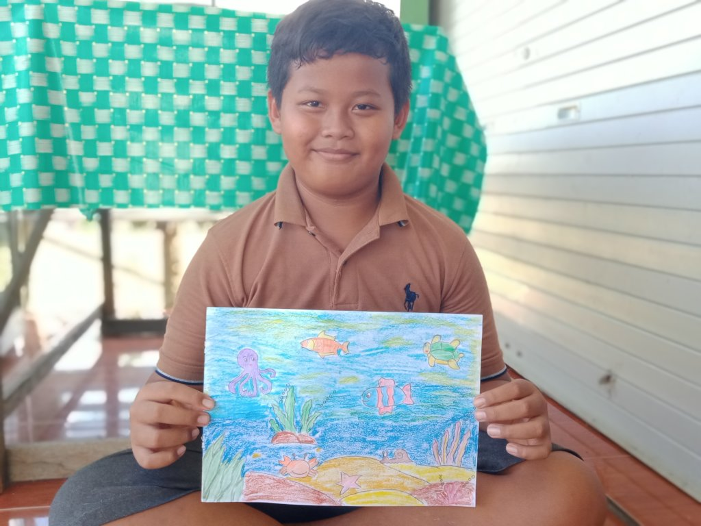 The boy with his drawing creation