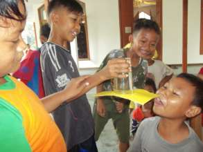 The children trying the experiment by themselves