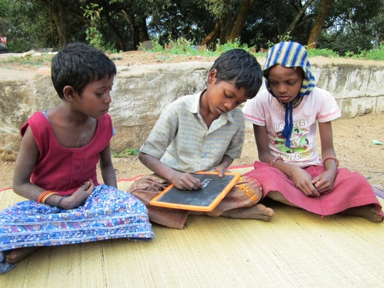 a group of tribe children under educationa program