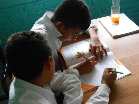 Students using the IMIFAP workbooks