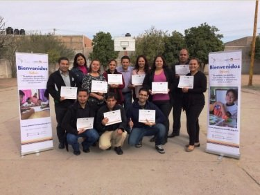 Teachers with their program certificates
