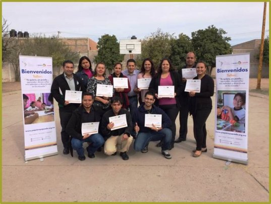 Happy teachers with their diplomas