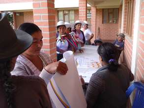 Handing out information material at a workshop