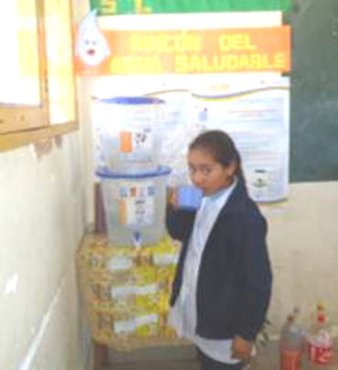 Girl consuming safe drinking water from a filter