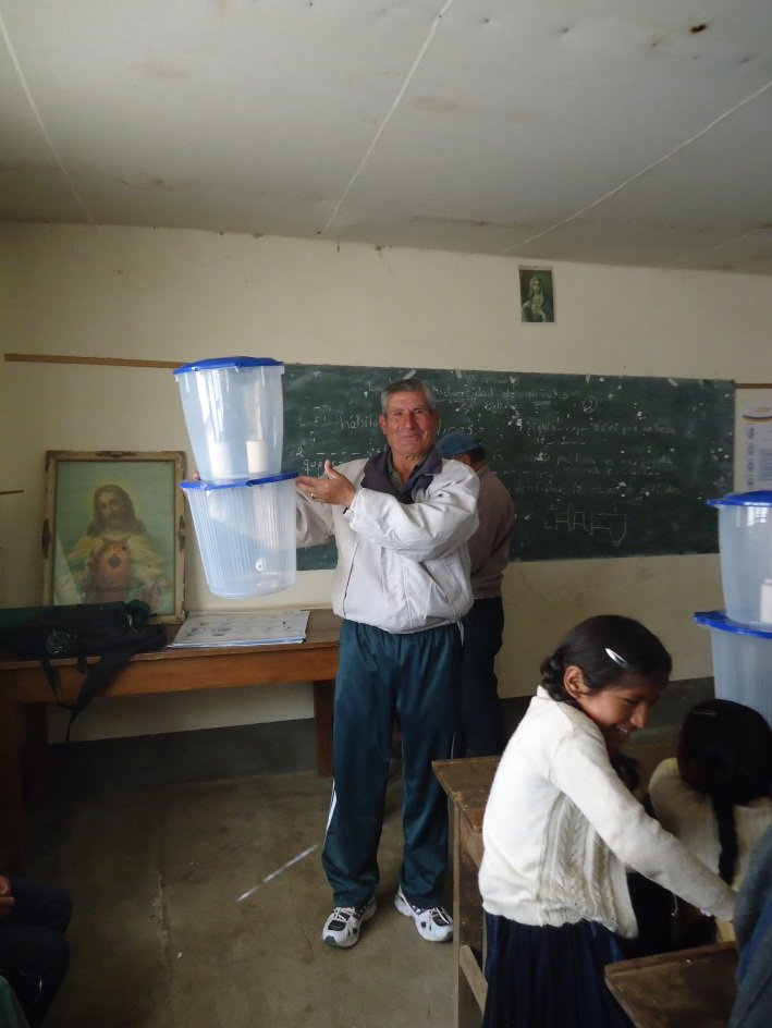 Teacher Roger Teran with one of the water filters
