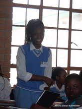 Grace giving a presentation at Daktari Eco-club.