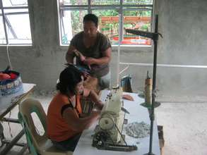 Local women using the sewing machines you provided